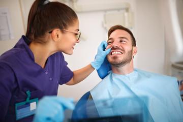 Dentist looking patient's teeth