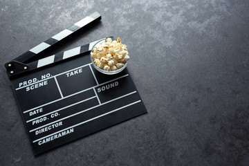 Cinema concept with movie theatre elements set of clapper board and popcorn.