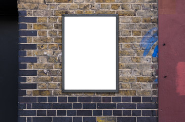 Blank advertising A1 poster billboard on brick wall