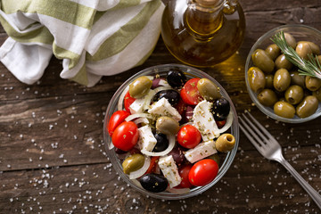 Mediterranean salad with feta cheese and Greek olives top view .