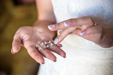 Bride shows wedding ring. Brideshows the wedding ring to friends.