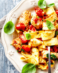 Tagliatelle pasta with grilled chicken fillet and cherry tomatoes