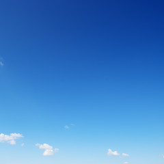 Small white cloud against bright blue sky.