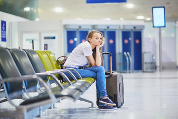Woman in international airport waiting for her flight