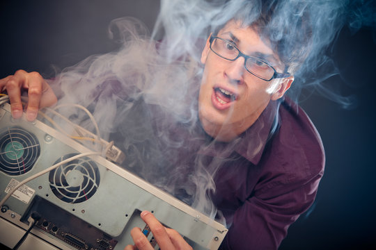 Nerd With Smoke Coming Out Of His Pc