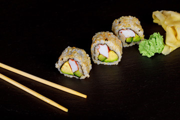 Sushi roll sushi with prawn, avocado, cream cheese, sesame. Japanese food.