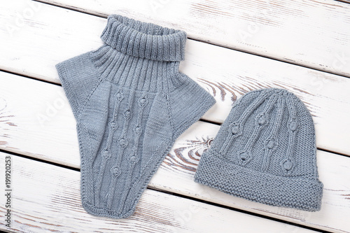 a9f2e106a9a Set of female knitted hat and scarf. Stylish feminine blue knit snood and  cap