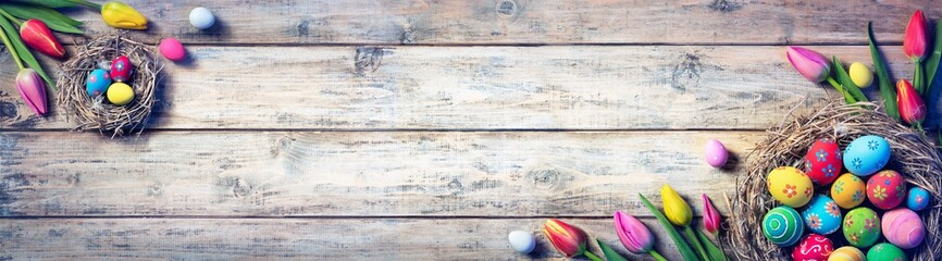 Tulips And Painted Eggs In Nests On Vintage Plank