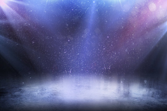 Beautiful empty winter background and empty ice rink with lights.