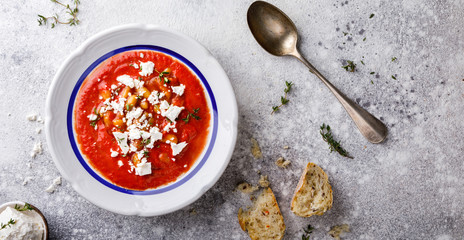 Tomato soup  and fresh tomatoes cherry  on a wooden background Gazpacho