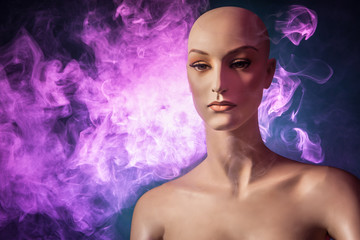 Woman mannequin in smoke. Smoking and electronic cigarettes. Mannequin in the tubers of steam.
