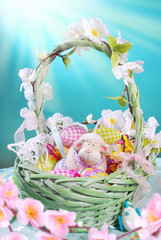 easter basket with eggs and spring decoration