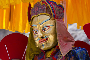 Tibetan lamas dressed in mystical mask dance Tsam mystery in time of buddhist festival at Hemis Gompa, Ladakh, North India