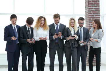 business team looking to smartphone in office