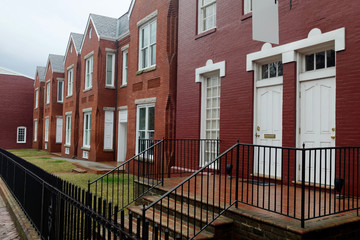 Renovated brick row houses in the rain. Richmond, Virginia.