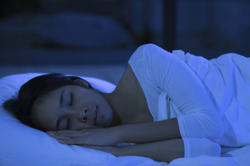 Asian women are sleeping at night.