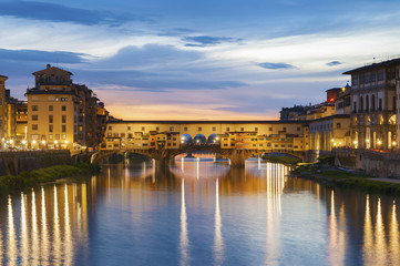 Wall Mural - Ponte Vecchio - the bridge-market in the center of Florence, Tuscany, Italy at dusk