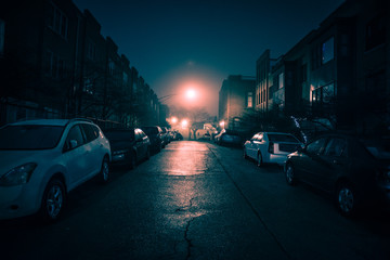Wall Mural - Dark wet city street with cars at night with fog.