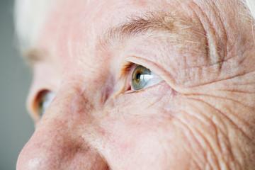 Closeup side portrait of white elderly woman eyes
