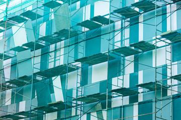 scaffolding on building facade. fall-protection safety net. building facade renovation.