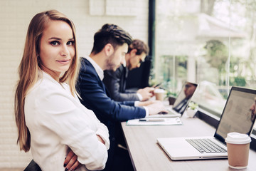 Business woman working with business team by laptop computer. Beauty and Technology concept. Smart lady and working woman theme. Office and happy life theme.