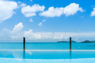luxury pool villa sea view, blue cloud sky, background is beautiful island.