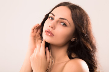 brunette woman with nice face posing at camera. beauty concept.