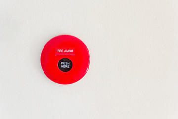 fire alarm mounted on cement wall for warning and security system