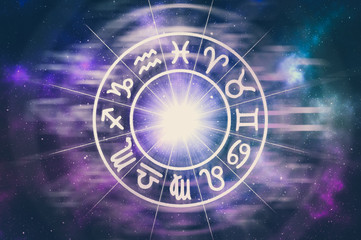 Zodiac signs inside of horoscope circle on universe background