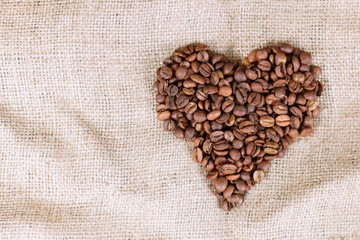 Coffee grain in the shape of a heart on the burlap