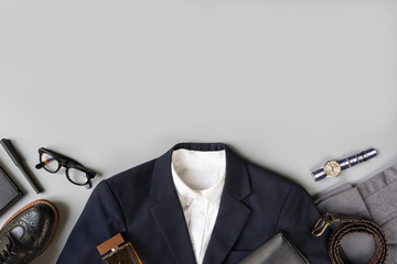 Top view of business clothing, Set of classic fashion and accessories with copy space on grey background Wall mural
