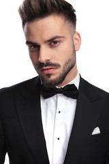 closeup portrait of a young handsome man in tuxedo