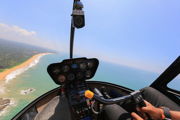 Helicopter view inside the cabin flies over the ocean in Sri Lanka