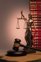 gavel, law books and justice statue