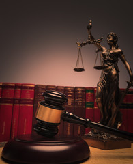 judge's gavel with justice statue and law book