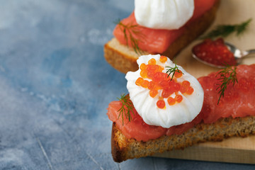 Useful breakfast with your own hands, a sandwich with egg - poached, caviar and red fish with space for text