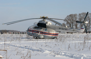A helicopter of the Russian Emergency Situations Ministry is seen at the crash site of the short-haul AN-148 airplane operated by Saratov Airlines in Moscow Region