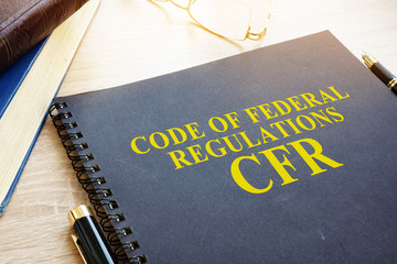 Code of Federal Regulations (CFR) and glasses. Wall mural