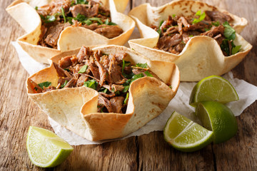 Mexican barbacoa tacos with spicy pulled beef close-up. Horizontal