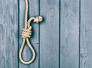 Hinge for the gallows on a blue wooden background.