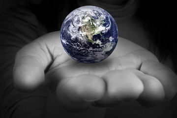 woman holding the planet earth in the hands. Elements of this image furnished by NASA