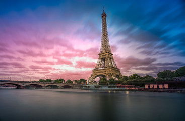 Long exposure photographyof the Eiffel Tower from Seine river in the evening time