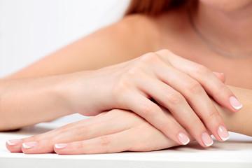 Closeup shot of beautiful female hands with long fingers