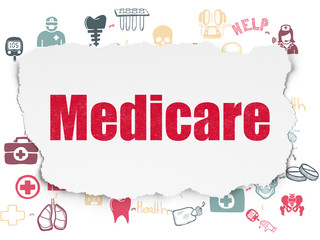 Health concept: Painted red text Medicare on Torn Paper background with Scheme Of Hand Drawn Medicine Icons