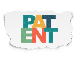 Law concept: Painted multicolor text Patent on Torn Paper background