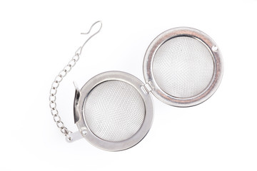 Tea strainer on a chain isolated white background.
