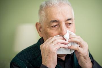 Senior blowing nose
