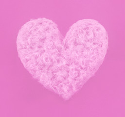 Pink heart made of sweet cotton candy on paper background. Trendy minimal pop art style. Happy Valentines day.