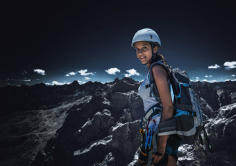Young female climber standing in mountains