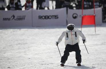A robot takes part in the Ski Robot Challenge at a ski resort in Hoenseong